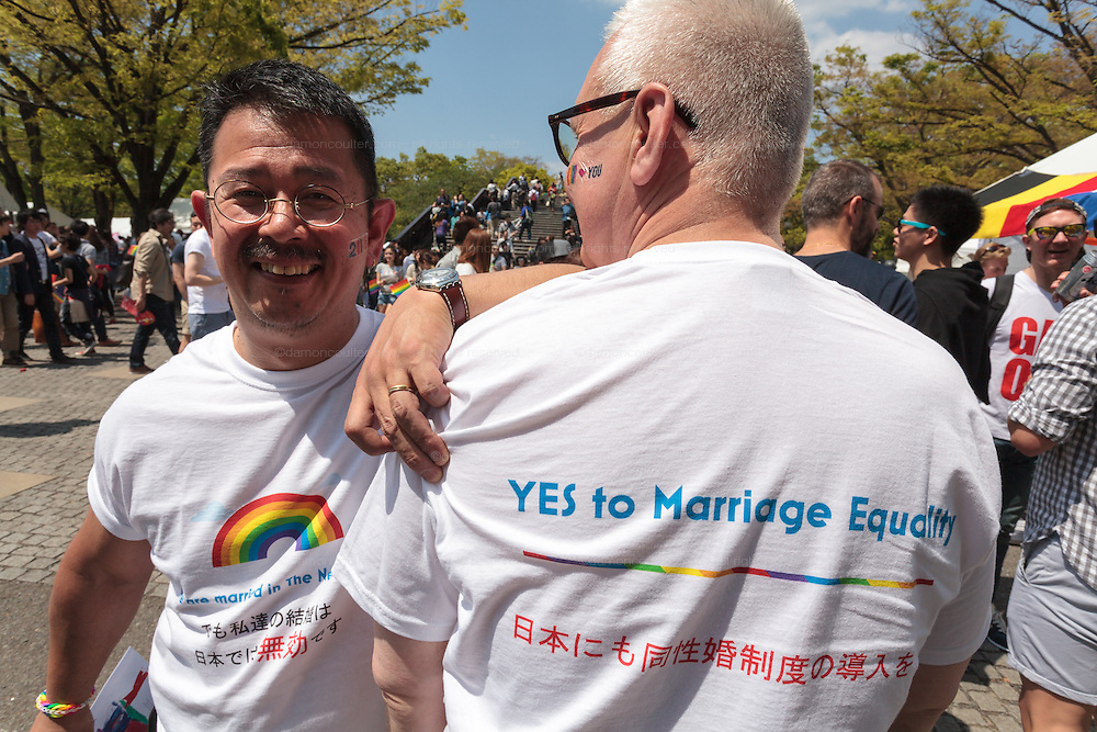 A gay couple were T-shirts supporting gay marriage at The Rainbow Pride Event in Yoyogi Park, Shibuya, Tokyo, Japan. Sunday, April 26th 2015. This is the forth annual celebration of LGBT issues in Tokyo and forms part of a wider Rainbow Week. About 5% of the Japanese population identify as homosexual and this event hopes to foster a society where they can live equally and without prejudice.