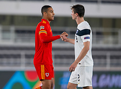 HELSINKI, FINLAND - Thursday, September 3, 2020: Wales' Ben Cabango (L) and Finland's Daniel O'Shaughnessy at the final whistle during the UEFA Nations League Group Stage League B Group 4 match between Finland and Wales at the Helsingin Olympiastadion. Wales won 1-0. (Pic by Jussi Eskola/Propaganda)