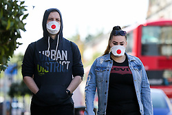 © Licensed to London News Pictures. 22/04/2020. London, UK. People wearing face masks in north London during the coronavirus lockdown. Members of the public will be asked to wear face masks in public to stop the spread of COVID-19. Photo credit: Dinendra Haria/LNP