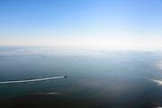 Nederland, Friesland, Terschelling, 07-05-2018; Waddenzee met de vaargeul tussen Harlingen en Vlieland.<br /> Snelboot - catamaran-boot - Tiger van rederij Doeksen.<br /> Wadden Sea with the channel between Harlingen and Vlieland, and the fast (catamaran) boat - Tiger from shipping company Doeksen.<br /> <br /> luchtfoto (toeslag op standaard tarieven);<br /> aerial photo (additional fee required);<br /> copyright foto/photo Siebe Swart