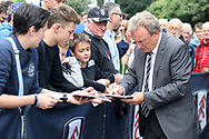 Cardiff City Manager Neil Warnock signs autographs for fans as he arrives for the game. . EFL Skybet football league championship match, Fulham v Cardiff city at Craven Cottage in London on Saturday 9th September 2017.<br /> pic by Steffan Bowen, Andrew Orchard sports photography.
