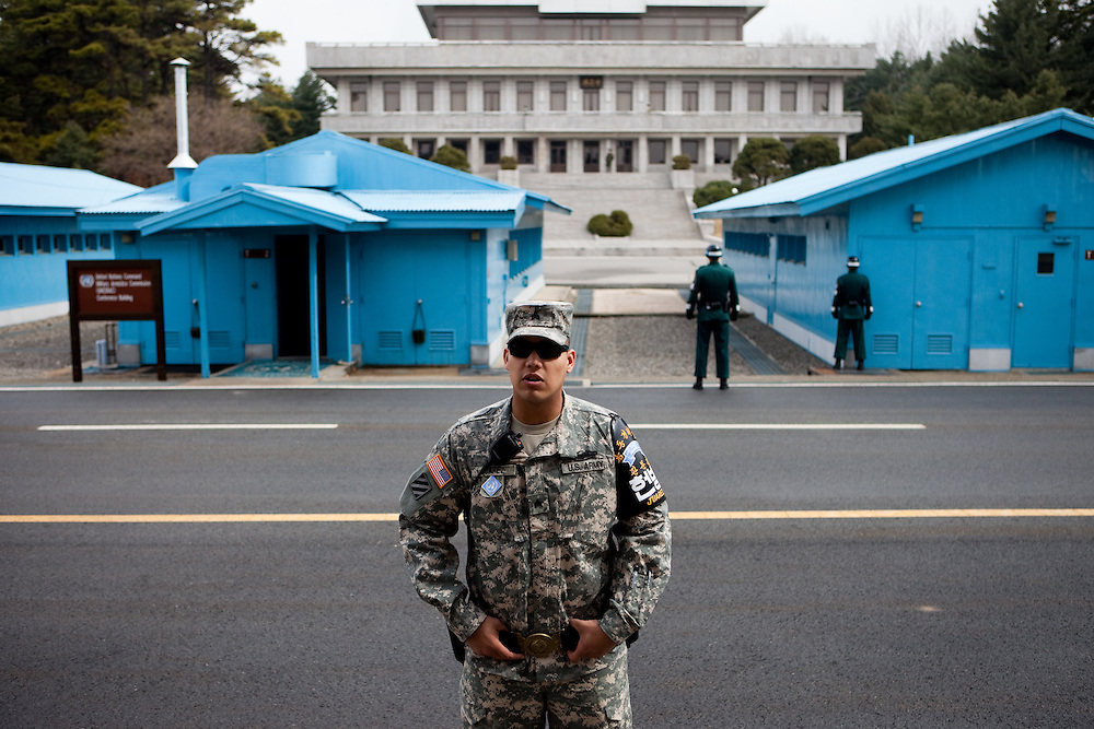 "An American soldier is briefing visitors at the Joint Security Area (JSA). The Joint Security Area or Panmunjom, often called the ""Truce Village""  is the only portion of the Korean Demilitarized Zone (DMZ) where South and North Korean forces stand face-to-face. The area is used by the two Koreas for diplomatic engagements and, until March 1991, was also the site of military negotiations between North Korea and the United Nations Command (UNC). South Korea, Republic of Korea, KOR, 23rd of March 2010."