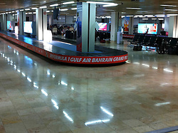 © under license to London News Pictures. 22/02/2011. A deserted Bahrain International Airport baggage caracole is still adverising the cancelled Grand Prix. Photo credit should read Michael Graae/London News Pictures