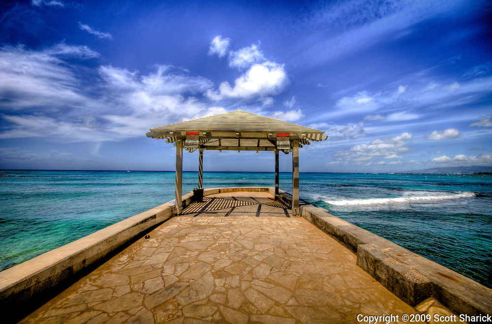 An empty pier in Waikiki as an HDR image.