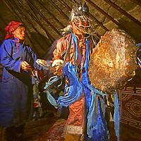 MONGOLIA, Darhad Valley.  A shaman named Umgan dances, chants and beats his drums to invoke spirits during a trance in his ger (yurt).