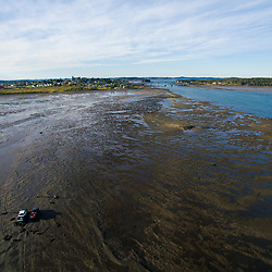 Clammers at low tide in Lubec Channel in Lubec, Maine.