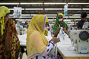 Najma (centre) working on a sewing machine at an Epyllion Group garment factory in Dhaka, Bangladesh.