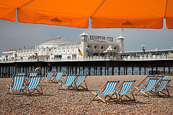 © Licensed to London News Pictures. 31/05/2014. Brighton, UK. Deck chairs for hire on Brighton Beach. The weekend is expected to reach temperatures of 20C down the South Coast according to the MET office. Photo credit : Hugo Michiels/LNP