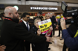 © Licensed to London News Pictures. 06/11/2019. Birmingham, UK. A small group of protesters are ejected before Prime Minister Boris Johnson launches the Conservative Party election campaign at the NEC in Birmingham. Today is the first oficial day of the 2019 general election. Voters go to the polls on December 12th 2019. Photo credit: Peter Macdiarmid/LNP