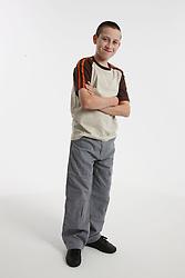 Studio portrait of white teenage boy