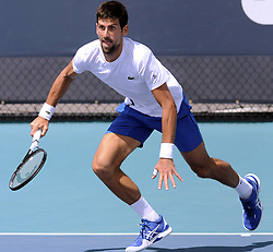 March 21, 2019 - Miami, FL, United States - Novak Djokovic of Serbia runs to return a shot on the practice courts at the Hard Rock Stadium at the Miami Open on March 21, 2019 in Miami Gardens, Florida. (Credit Image: © Paul Hennessy/NurPhoto via ZUMA Press)