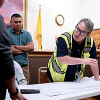Public Works Director Stanley Henderson explains how water will be routed during the whole block reconstruction project on the southside of town during City Councilor Yogash Kumar's neighborhood meeting Monday evening.