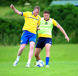 Bristol Rovers' defender, Tom Parkes jostles for the ball with David Clarkson - Photo mandatory by-line: Dougie Allward/JMP - Tel: Mobile: 07966 386802 24/06/2013 - SPORT - FOOTBALL - Bristol -  Bristol Rovers - Pre Season Training - Npower League Two