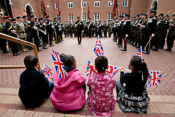 © licensed to London News Pictures. London, UK 10/03/2012. Children are watching London's Territorial Army soldiers, many of whom have taken part in overseas operations in Iraq and Afghanistan standing outside Kensington Town Hall this noon (10/03/12). Photo credit: Tolga Akmen/LNP