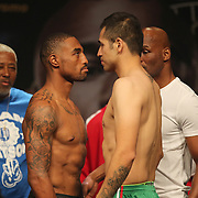 """J'Leon Love (left) and Marco Periban stare each other down during the official weigh-ins for the Mayweather versus Maidana boxing match slated as """"The Moment"""", at the MGM Grand hotel on Friday, May 2, 2014 in Las Vegas, Nevada.  (AP Photo/Alex Menendez)"""