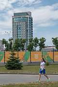 A female volunteer walks towards the athletes village for the 2nd European Games on the 20th June 2019 in Minsk in Belarus. The 2nd European Games is held in Minsk, Belarus from the 21st June to the 30th June.