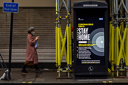 © Licensed to London News Pictures. 21/12/2020. LONDON, UK. A digital sign shows a Tier 4, Stay at Home, alert level message at a telephone box near Chinaatown. Tier 4 restrictions are imposed on much of the UK to combat the ongoing coronavirus pandemic in the light of a recently discovered mutant strain that was discovered to be spreading in the south east of England.  Photo credit: Stephen Chung/LNP