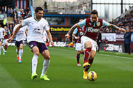 Burnley's Danny Ings under pressure from Everton's Antolin Alcaraz. Barclays Premier league match, Burnley v Everton at Turf Moor in Burnley, Lancs on Sunday 26th October 2014.<br /> pic by Chris Stading, Andrew Orchard sports photography.