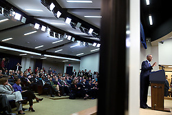 President Barack Obama delivers remarks to the audience, seen reflected in a mirror, at the Global Health Security Agenda Summit in the Eisenhower Executive Office Building South Court Auditorium, Sept. 26, 2014. (Official White House Photo by Pete Souza)<br /> <br /> This official White House photograph is being made available only for publication by news organizations and/or for personal use printing by the subject(s) of the photograph. The photograph may not be manipulated in any way and may not be used in commercial or political materials, advertisements, emails, products, promotions that in any way suggests approval or endorsement of the President, the First Family, or the White House.