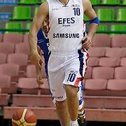 Efes Pilsen's Kerem TUNCERI during their Turkish Basketball league match Efes Pilsen between Antalya BSB at the Ayhan Sahenk Arena in Istanbul Turkey on Wednesday 21 April 2010. Photo by Aykut AKICI/TURKPIX