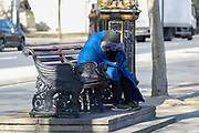 "A homeless person is seen enjoying the sunshine on a bench nearby Westminster Pier Thames Clippers on Tuesday morning, March 24, 2020. Homeless people are at particular risk of contracting the coronavirus with the systems that care for them poorly equipped to handle a major outbreak. Vigilant hygiene can prevent transmission, health experts say, but that is likely to be a challenge for people living without homes. Hundreds of homeless people in London are being housed in hotels to self-isolate to provide them with ""vital protection"" from the coronavirus, the city's mayor, Sadiq Khan, announced. Three hundred rooms have been made available in two hotels for the next 12 weeks, the mayor's office said in a statement. An estimated 320,000 people are homeless in the UK, according to the latest research by Shelter. This equates to one in every 201 Brits and was an increase of four per cent on the previous year's number.<br /> (Photo/Vudi Xhymshiti)"