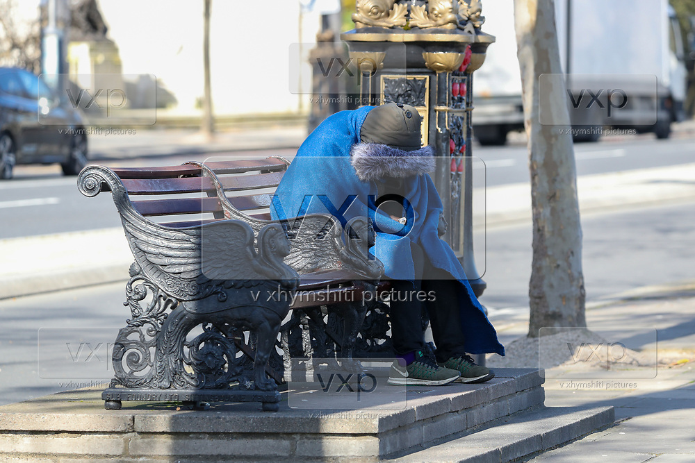 """A homeless person is seen enjoying the sunshine on a bench nearby Westminster Pier Thames Clippers on Tuesday morning, March 24, 2020. Homeless people are at particular risk of contracting the coronavirus with the systems that care for them poorly equipped to handle a major outbreak. Vigilant hygiene can prevent transmission, health experts say, but that is likely to be a challenge for people living without homes. Hundreds of homeless people in London are being housed in hotels to self-isolate to provide them with """"vital protection"""" from the coronavirus, the city's mayor, Sadiq Khan, announced. Three hundred rooms have been made available in two hotels for the next 12 weeks, the mayor's office said in a statement. An estimated 320,000 people are homeless in the UK, according to the latest research by Shelter. This equates to one in every 201 Brits and was an increase of four per cent on the previous year's number.<br /> (Photo/Vudi Xhymshiti)"""