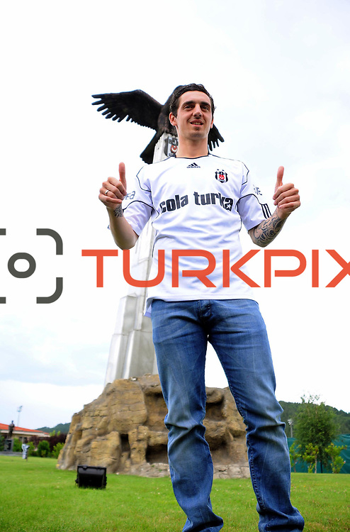 Turkish soccer team Besiktas's new player German Roberto HILBERT front of an eagle statue, symbol of Besiktas Istanbul, after a signing ceremony in Istanbul, Turkey on 22 June 2010. Besiktas signed a contract with Roberto HILBERT for three years. Photo by TURKPIX
