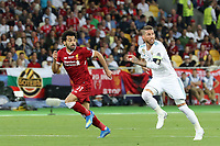 KIEV, UKRAINE - MAY 26: Mohamed Salah of Liverpool competes with Sergio Ramos of Real Madrid during the UEFA Champions League final between Real Madrid and Liverpool at NSC Olimpiyskiy Stadium on May 26, 2018 in Kiev, Ukraine. (MB Media)