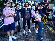 25 SEPTEMBER 2017 - RANGSIT, PATHUM THANI, THAILAND: People wait for buses at a transit station in Rangsit.       PHOTO BY JACK KURTZ