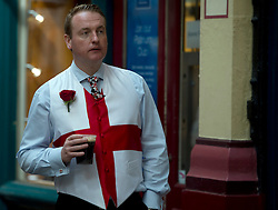 © Licensed to London News Pictures. 23/04/2015. <br /> LONDON, UK. Londoners celebrate Saint George's Day today in Leadenhall market with performances from morris dancers. A man dressed in English clothing enjoys a drink in the market, London, Thursday 23 April 2015. Photo credit : Hannah McKay/LNP