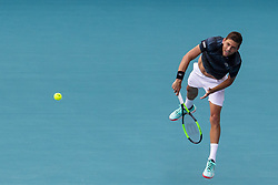 March 25, 2019 - Miami Gardens, FL, USA - Filip Krajinovic, of Serbia, serves against Roger Federer, of Switzerland, during their match at the Miami Open tennis tournament on Monday, March 25, 2019 at Hard Rock Stadium in Miami Gardens, Fla. (Credit Image: © Matias J. Ocner/Miami Herald/TNS via ZUMA Wire)