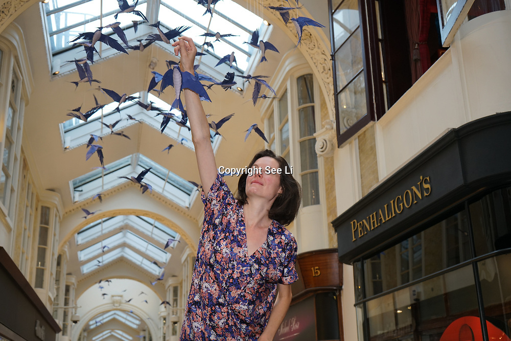 London, UK. 26th June 2017. French Designer Mathilde Nivet transforms Mayfair's Burlington Arcade with 300 paper birds to celebrate Mayfair Art Weekend in partnership with the Royal Acdemy of Arts.