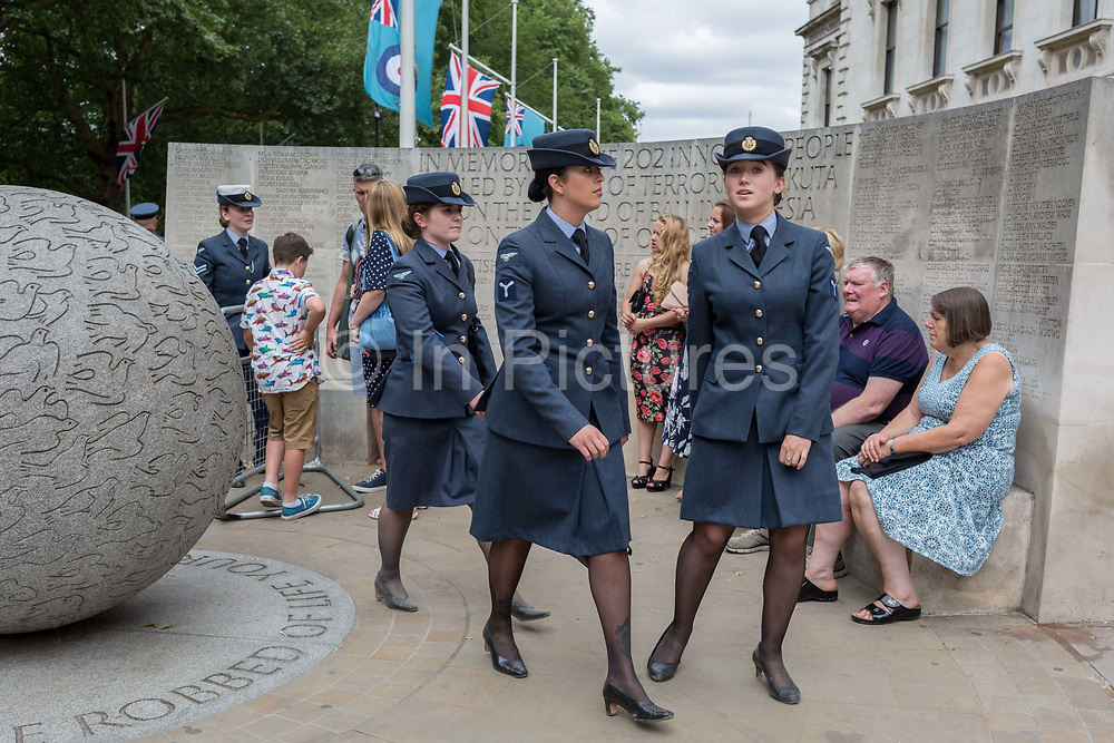 On the 100th anniversary of the Royal Air Force RAF and following a flypast of 100 aircraft formations representing Britains air defence history which flew over central London, women service personnel leave Horseguards, passing the memorial to those killed in the 2002 Bali bombing, on 10th July 2018, in London, England.