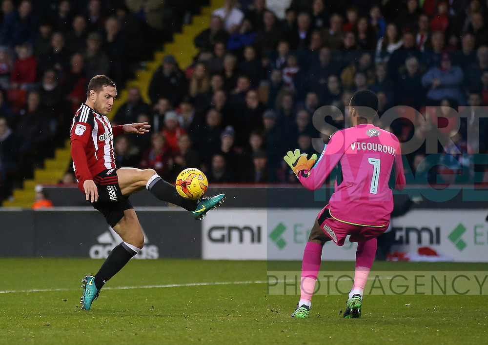 Billy Sharp of Sheffield Utd lobs Lawrence Vigouroux of Swindon Town  only for the ball to be cleared during the English League One match at Bramall Lane Stadium, Sheffield. Picture date: December 10th, 2016. Pic Simon Bellis/Sportimage