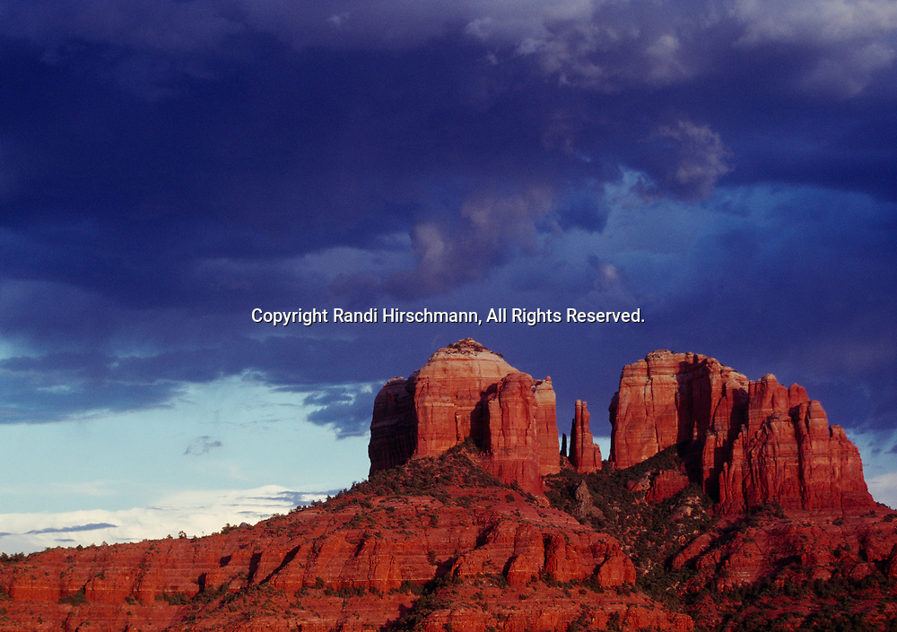 Sunset on Cathedral Rocks with departing storm, Coconino National Forest near Sedona, Arizona.