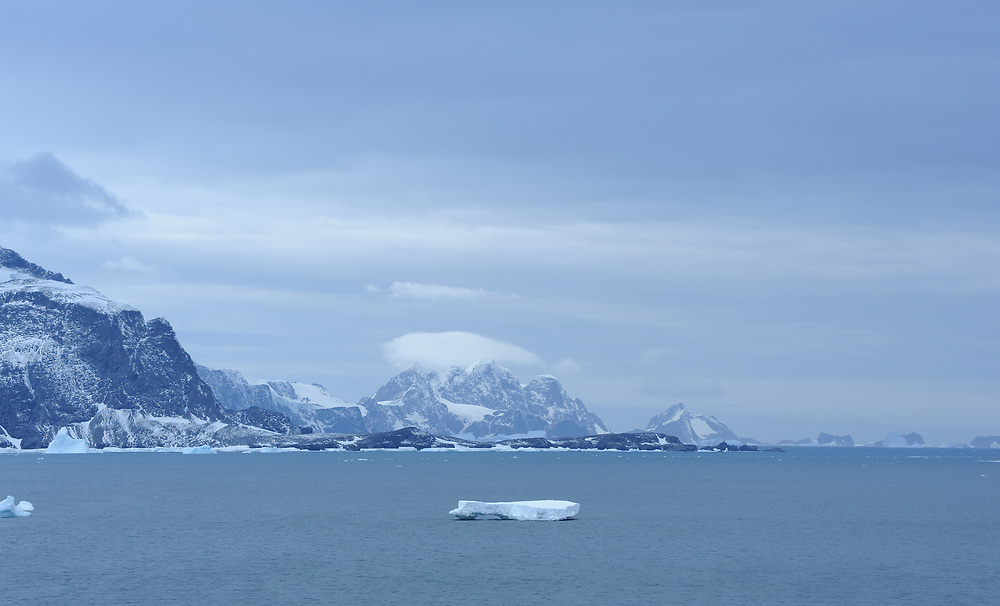 The mountains of Coronation Island and other South Orkney islands from Shingle Cove. Shingle Cove, Coronation Island, South Orkney Islands, Antarctica. 28Feb16