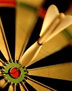 Close up, selective focus on dart in bullseye