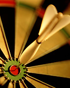 Close up, selective focus on dart in bullseye