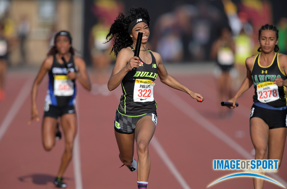 Apr 7, 2018; Arcadia, CA, USA; Leah Phillips (322) runs the anchor leg on the Bullis (Md.) girls 4 x 100m relay that won in 45.72 during the 51st Arcadia Invitational at Arcadia High.