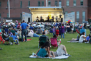 Middletown, New York - People relax on the baseball field and listen to the 1910 Fruitgum Company group perform on the stage before the fireworks displayat Fancher-Davidge Park during a Stars and Stripes celebration on July 2, 2011.
