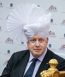 'Boris Johnson visits Hindu Temple. The Mayor of London Boris Johnson wears a 'Pagh' type of Turban during a visit to the Shree Swaminarayan Mandir, a major new Hindu temple being built in Kingsbury. Shree Swaminarayan Mandir, London, United Kingdom. Wednesday, 28th May 2014. Picture by Daniel Leal-Olivas / i-Images