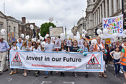 "© Licensed to London News Pictures. 16/07/2017. London, UK. Parents, pupils and teachers gather for an event called ""Carnival Against The Cuts"" marching to Parliament Square.  The demonstration, organised by Fair Funding For Schools, a parent led campaign, calls for the government to increase funding for schools.   Photo credit : Stephen Chung/LNP"