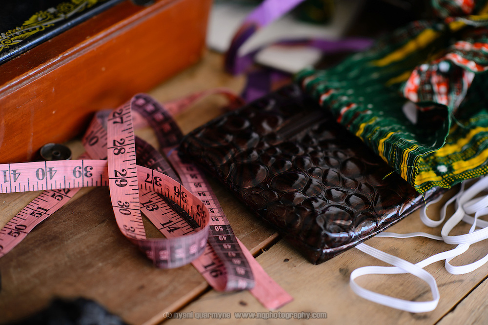 A measuring tape is seen in the shop of Alice Diaba, a seamstress, in Dabala Junction in the Volta Region of Ghana.