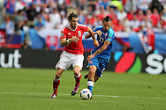 Gareth Bale of Wales breaks away from Marek Hamsik of Slovakia (r). Euro 2016, Wales v Slovakia at Matmut Atlantique , Nouveau Stade de Bordeaux  in Bordeaux, France on Saturday 11th June 2016, pic by  Andrew Orchard, Andrew Orchard sports photography.
