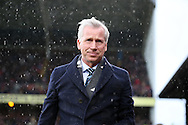 Alan Pardew, the Crystal Palace manager arrives at the dugout as he attempts to get out of the rain before k/o. Barclays Premier League match, Crystal Palace v Chelsea at Selhurst Park in London on Sunday 3rd Jan 2016. pic by John Patrick Fletcher, Andrew Orchard sports photography.