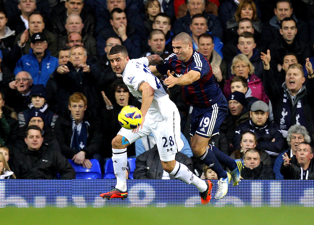 Tottenham Hotspur's Kyle Walker battles with Stoke City's Jonathan Walters ..Football - Barclays Premiership - Tottenham Hotspur v Stoke City - Saturday 22nd December 2012 - White Hart Lane - London..