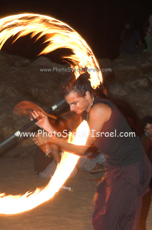 Man juggling fire night shot