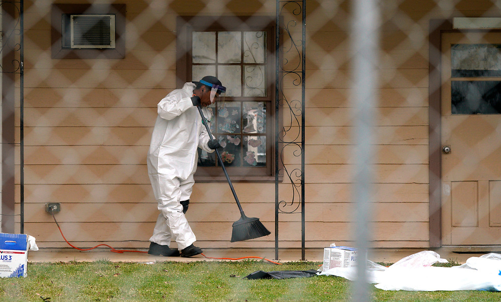 A worker sweeps the walk at the site of the shooting at the First Baptist Church of Sutherland Springs, Texas, U.S.  November 9, 2017.  REUTERS/Rick Wilking