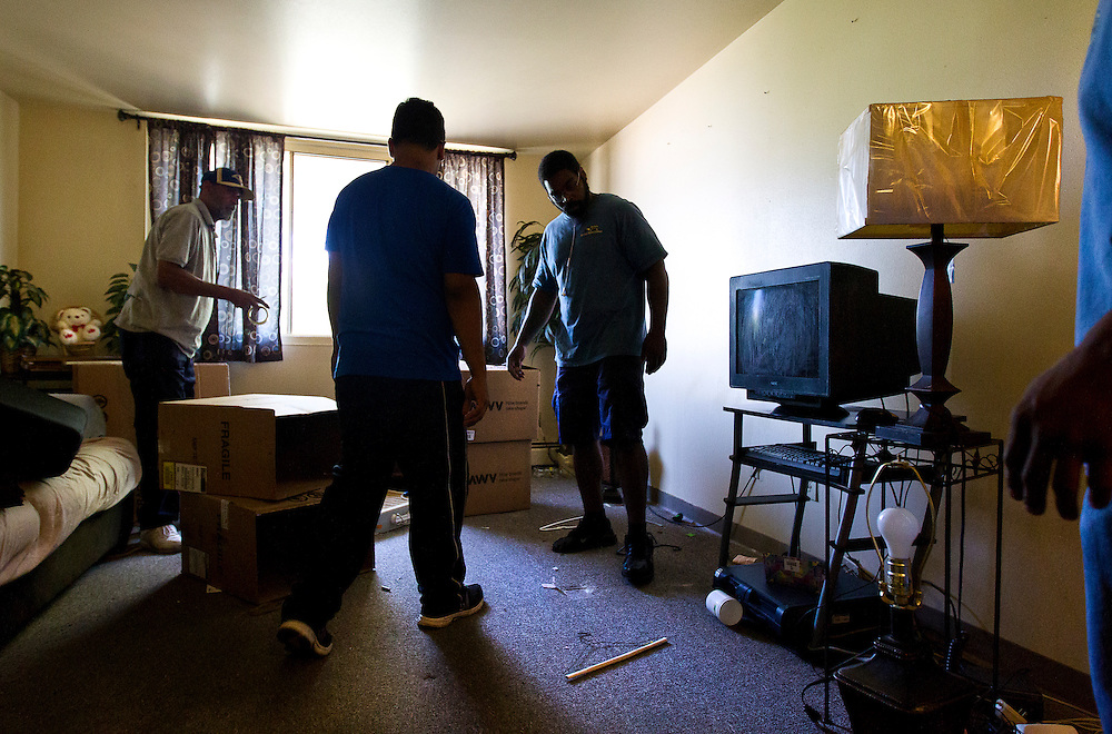 MILWAUKEE, WI — AUGUST 8, 2014: Movers from Eagle Moving and Storage Company box up belongings and furniture during an eviction at 714 West Galena Avenue in Milwaukee. The tenant was not present for the eviction.