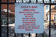 Dress code sign on a closed up bar on Broad Street as the Coronavirus lockdown continues, the city centre is still very quiet while more traffic and people are returning, and with restrictions due to be relaxed further in the coming days, the quiet city may be coming to an end as businesses are set to start to reopen soon on 27th May 2020 in Birmingham, England, United Kingdom. Coronavirus or Covid-19 is a respiratory illness that has not previously been seen in humans. While much or Europe has been placed into lockdown, the UK government has put in place more stringent rules as part of their long term strategy, and in particular social distancing.